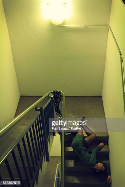 high angle view of woman murdered on staircase - murdered women stock pictures, royalty-free photos & images