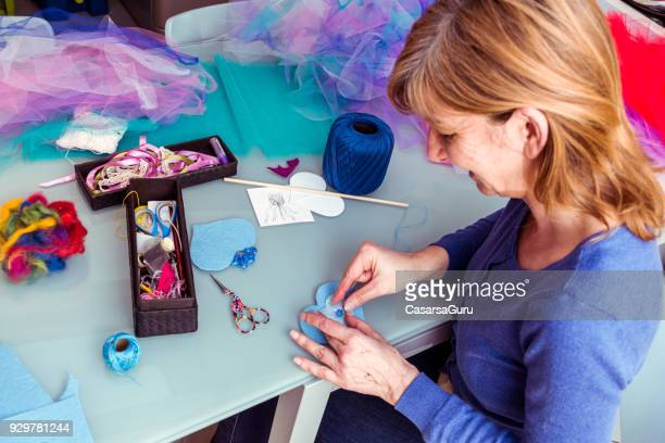 High Angle View Of Woman Sewing Magic Wand