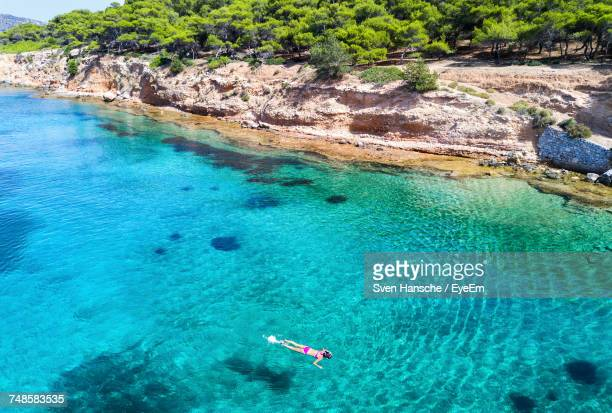 High Angle View Of Woman Snorkeling In Sea On Sunny Day