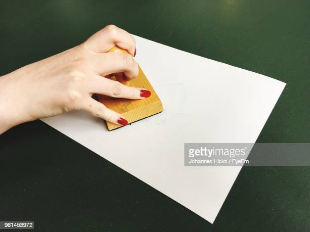 High Angle View Of Woman Stamping On Paper