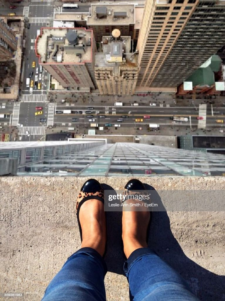 High Angle View Of Woman Standing On Rooftop : Stock Photo
