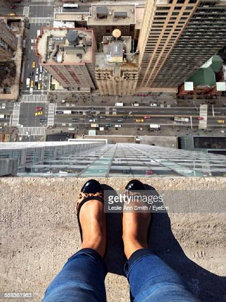 high angle view of woman standing on rooftop - high up stock photos and pictures