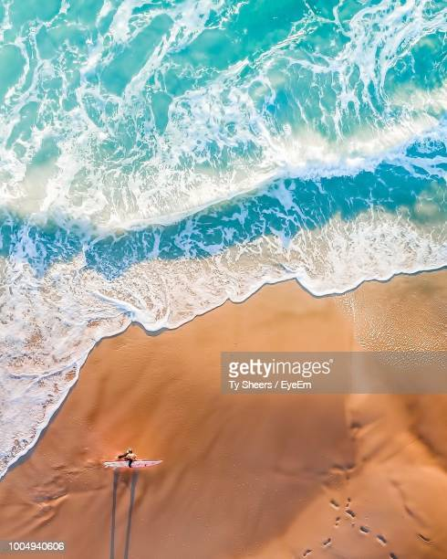 High Angle View Of Woman Walking At Beach