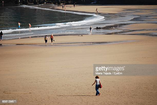 high angle view of woman walking at beach - maria tejada stock pictures, royalty-free photos & images