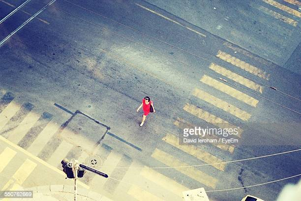 High Angle View Of Woman Walking On City Street