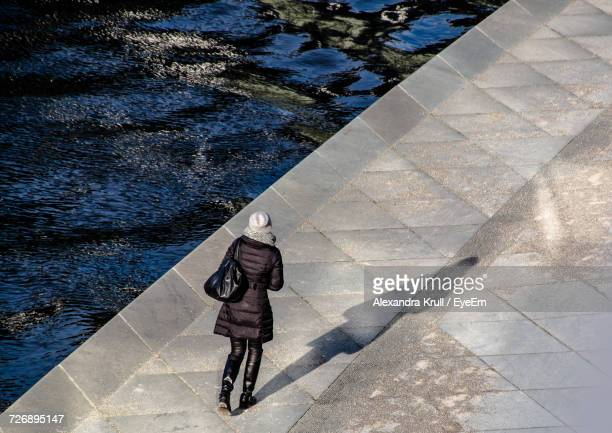 High Angle View Of Woman Walking On Promenade During Winter