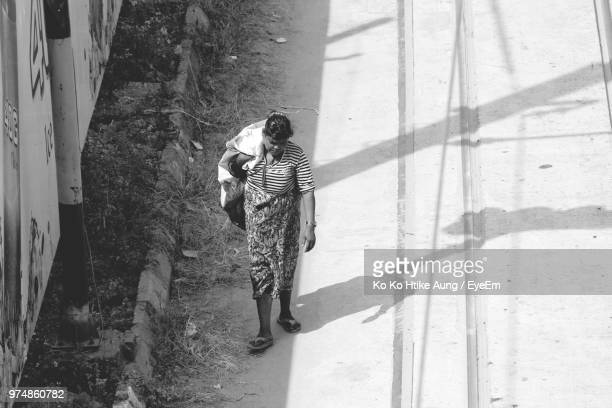 high angle view of woman walking on road - ko ko htike aung stock pictures, royalty-free photos & images