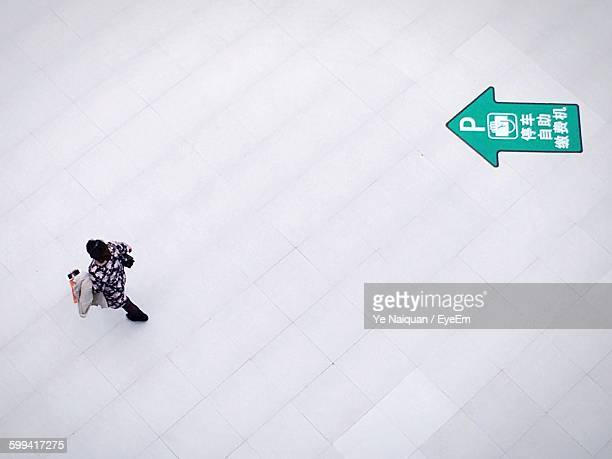 High Angle View Of Woman Walking Over White Surface