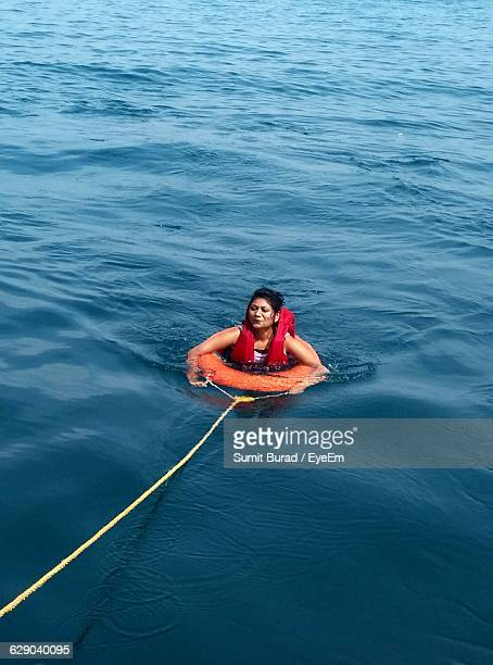 High Angle View Of Woman With Lifebelt In Sea