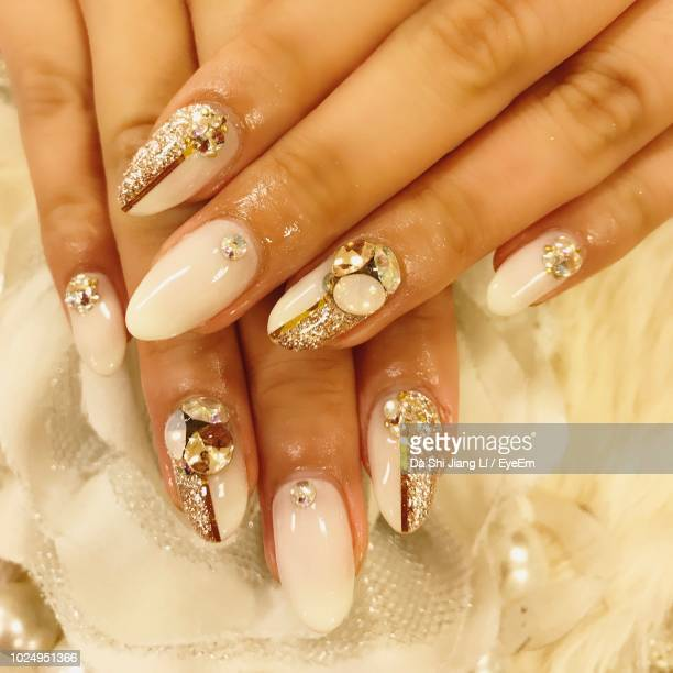 High Angle View Of Woman With Nail Art