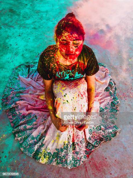 High Angle View Of Woman With Powder Paints During Holi