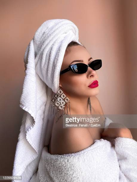 high angle view of woman with towel wearing sunglasses - beatrice stock pictures, royalty-free photos & images
