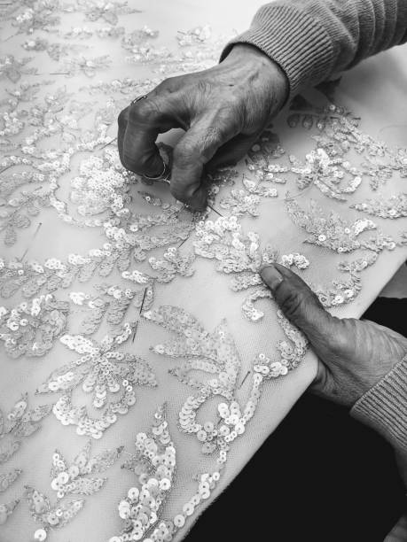 High Angle View Of Woman Working On Fabric