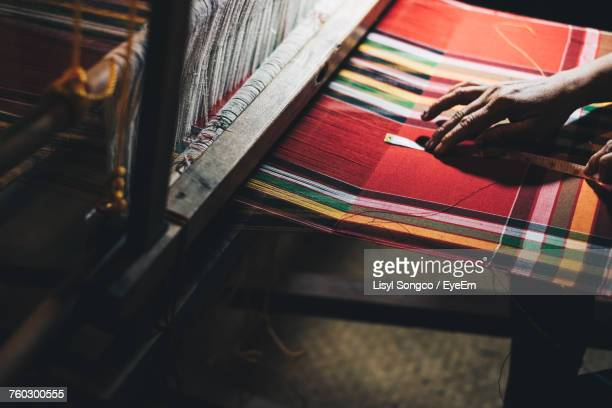 high angle view of woman working on loom - loom stock pictures, royalty-free photos & images