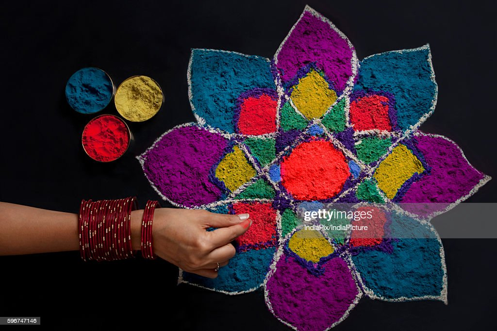 High angle view of woman's hand making rangoli : Stock Photo