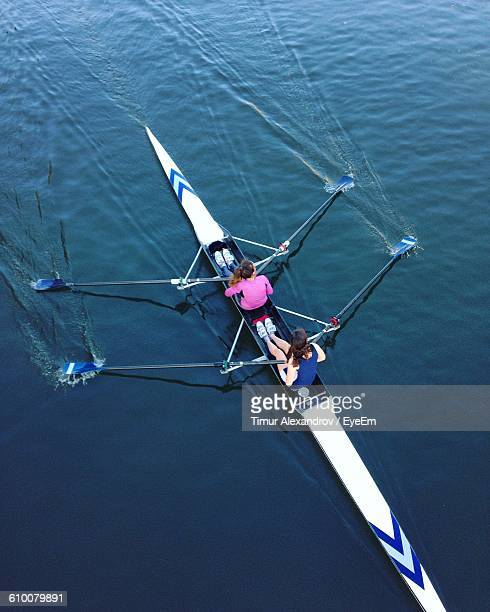 High Angle View Of Women Rowing On River