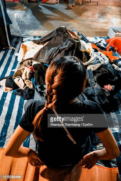 high angle view of women sitting on floor - one night stand stock-fotos und bilder