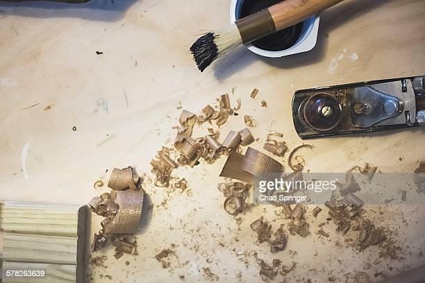 High angle view of wood plane and wood shavings