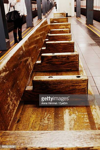 High Angle View Of Wooden Bench At Railroad Station Platform