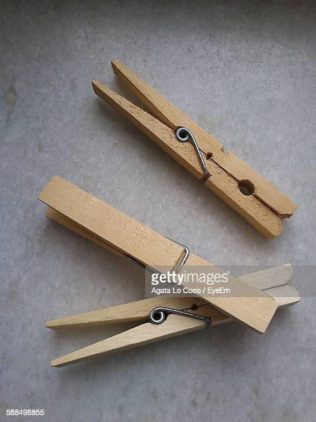 High Angle View Of Wooden Clothespins On Table