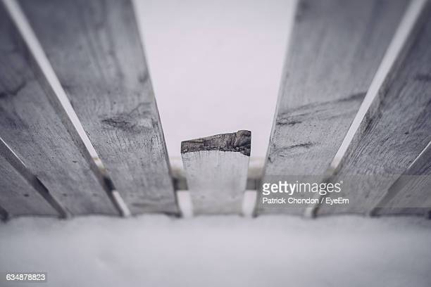 High Angle View Of Wooden Fence On Snow Covered Field