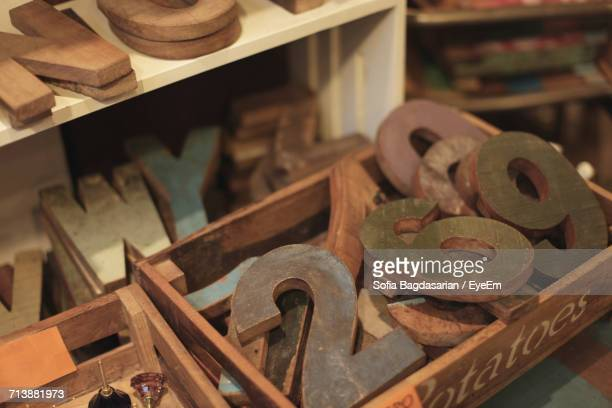 High Angle View Of Wooden Numbers And Alphabets