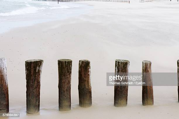 High Angle View Of Wooden Posts In Sea