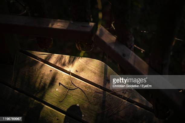 high angle view of wooden table - christian soldatke stock pictures, royalty-free photos & images