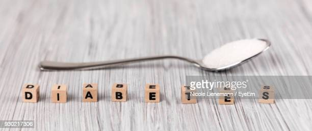 High Angle View Of Wooden Toy Blocks By Spoon On Table