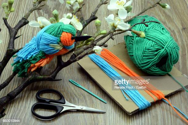 High Angle View Of Woolen Colorful Crafts On Table
