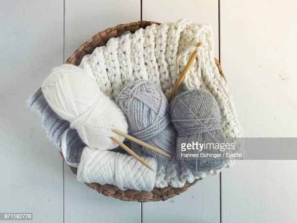 high angle view of woolen knitted sweater on table - wollig stockfoto's en -beelden