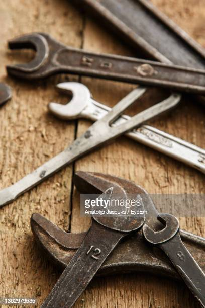 high angle view of work tools on wooden table - weaponry stock pictures, royalty-free photos & images