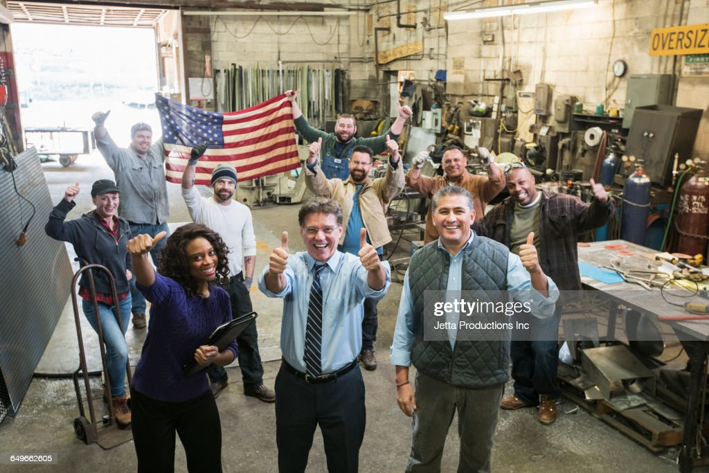 High angle view of workers cheering in workshop : Stock Photo