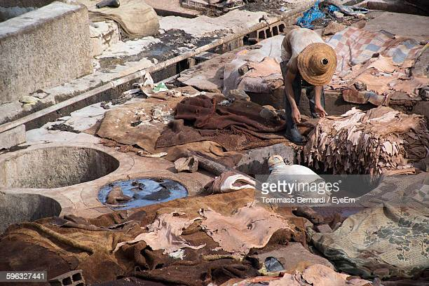 High Angle View Of Workers Tanning Leather In Pits