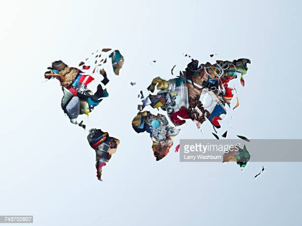 high angle view of world map outline over objects - world map stock photos and pictures