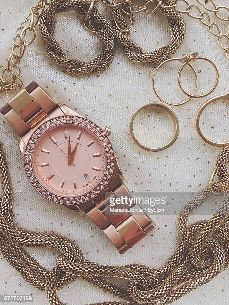 high angle view of wristwatch and necklace on table - 服飾品 ストックフォトと画像