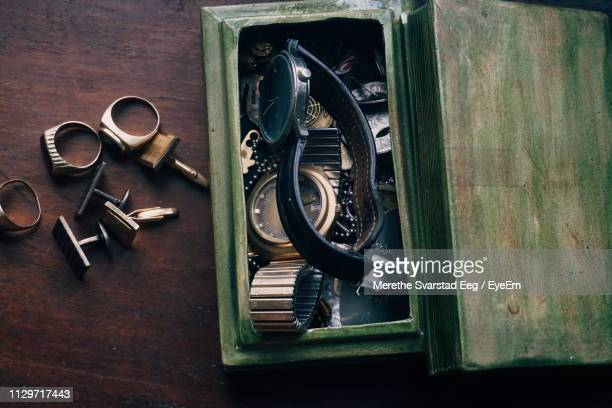 high angle view of wristwatches in box on table - 骨董品 ストックフォトと画像