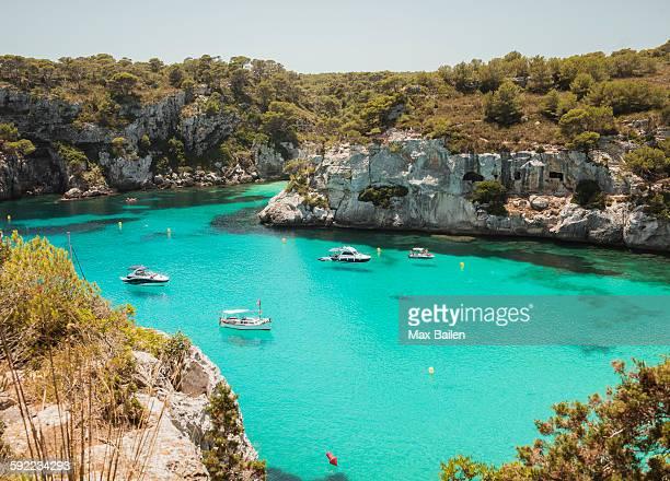 high angle view of yachts anchored at cala macarella, menorca, spain - カラマカレラ ストックフォトと画像