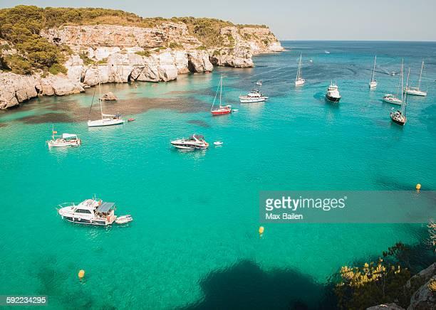 high angle view of yachts anchored in bay at cala macarella, menorca, spain - カラマカレラ ストックフォトと画像