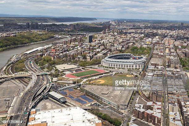 High Angle View Of Yankee Stadium Amidst Cityscape