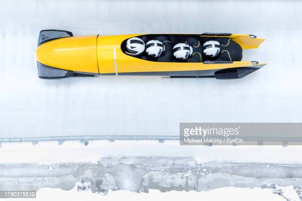 high angle view of yellow bobsled - bobsleigh stock pictures, royalty-free photos & images