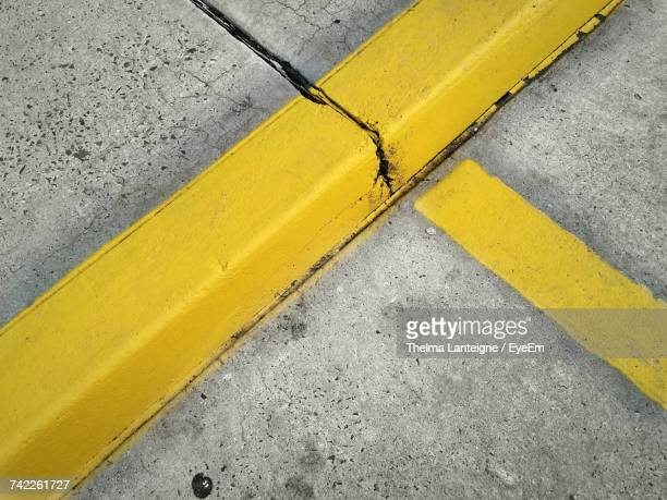 High Angle View Of Yellow Curb By Road