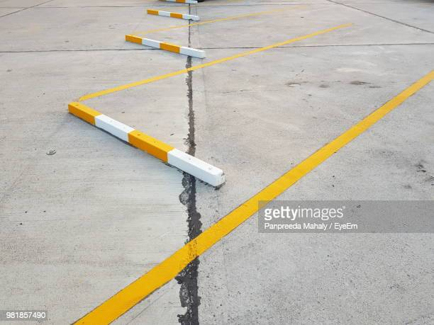high angle view of yellow marking on road - double yellow line stock photos and pictures