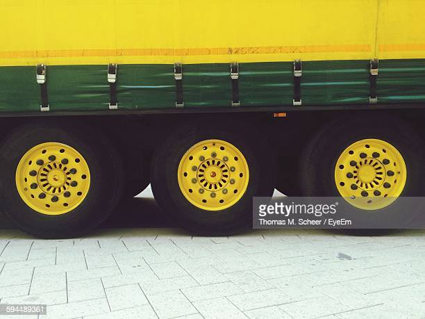 High Angle View Of Yellow Semi-Truck Tires