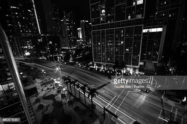 high angle view of yellow taxi on road against buildings at night - isolated color stock pictures, royalty-free photos & images