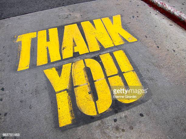 High angle view of yellow thank you text on road