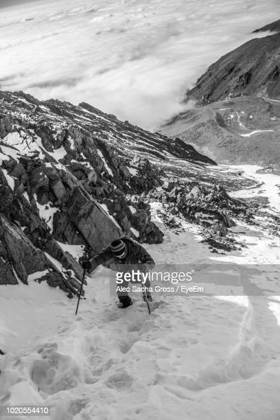 High Angle View Of Young Man Skiing On Snowcapped Mountain