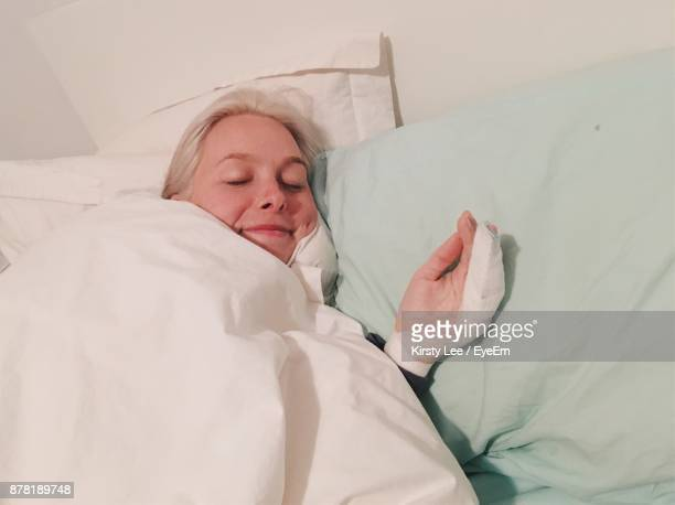 High Angle View Of Young Woman Sleeping On Bed At Hospital