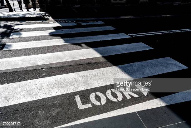 high angle view of zebra crossing in city - frank schrader stock pictures, royalty-free photos & images