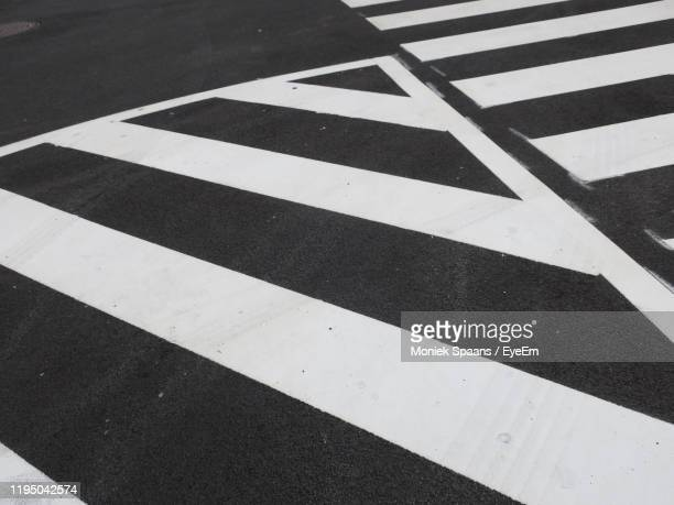high angle view of zebra crossing on road - dividing line road marking stock pictures, royalty-free photos & images